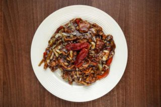 Spicy pork with onion and chili paprika delivery