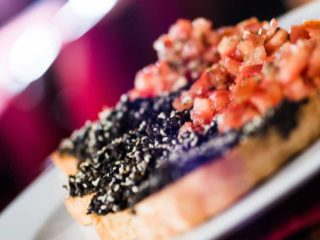Bruschetta with tomatoes and black olive paste delivery
