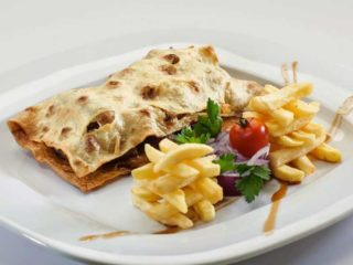 Veal cevap in traditional bread with kajmak and french fries delivery
