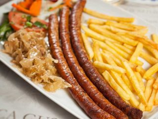 Home-made sausage with French fries delivery