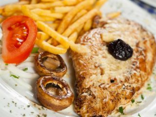 Stuffed grilled chicken with French fries delivery