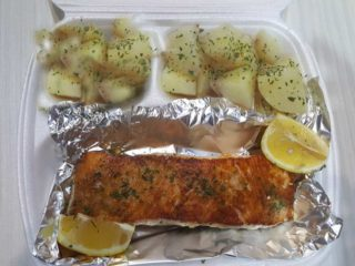 Grilled salmon fillet with side dish delivery