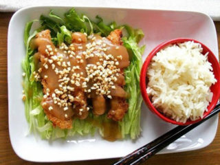 Fried chicken breasts with sesame in sauce of choice delivery