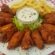 Buffalo wings in hot sauce