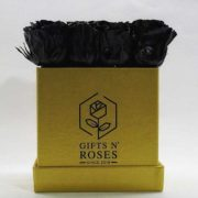 Golden box with black roses