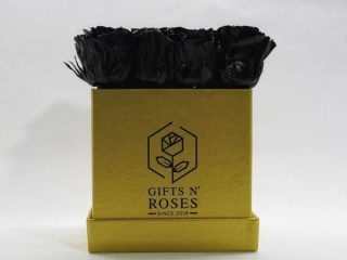 Golden box with black roses delivery