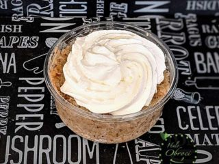Grain with nuts and whipped cream in a glass delivery