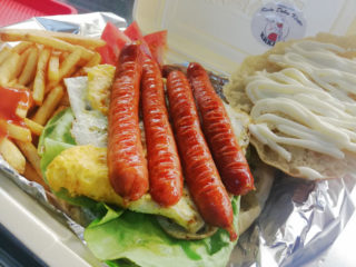 Sausage in bun breakfast delivery