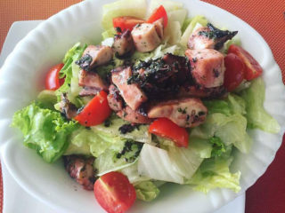 Salad with octopus and cheery tomato delivery